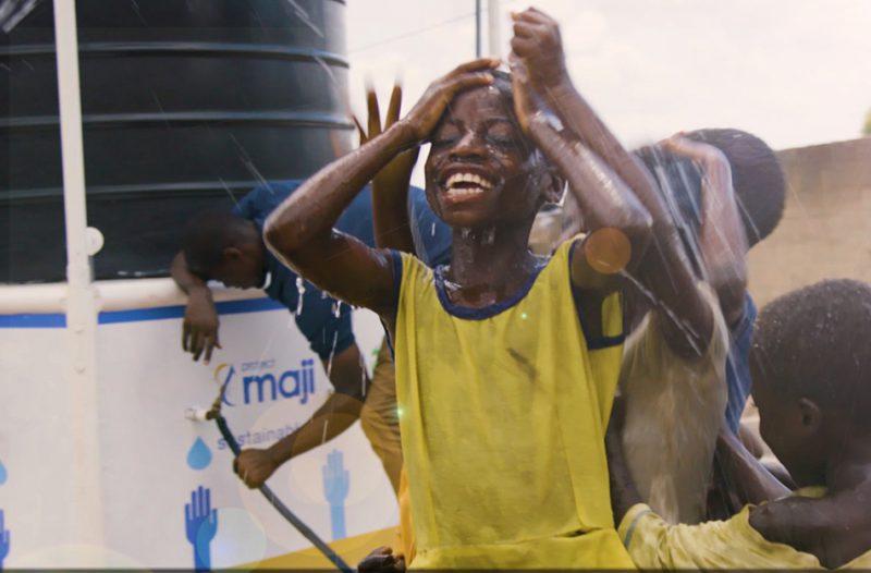 African child enjoying water