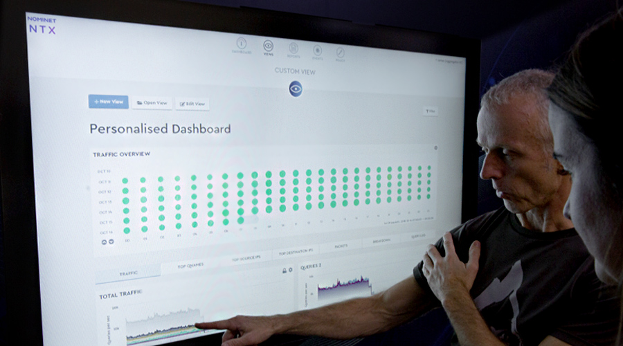 Man pointing at graph on computer screen