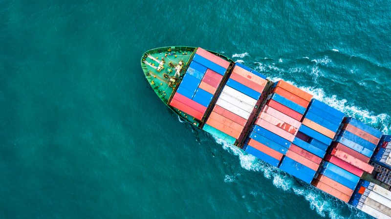 Aerial top view container cargo ship, Business logistic and transportation of International by ship in the open sea.