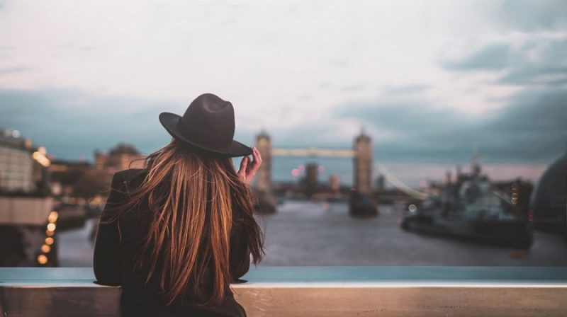 woman stood in front of London skyline
