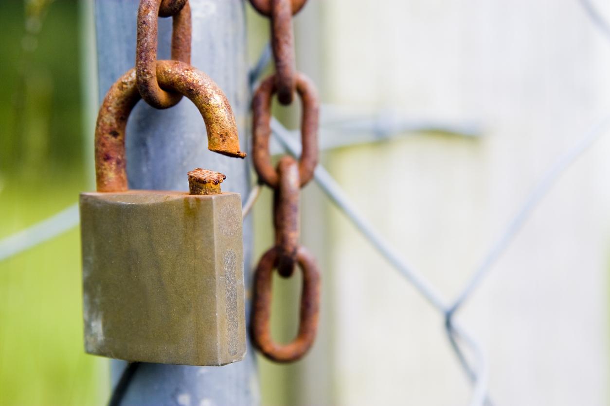 A cut rusty padlock