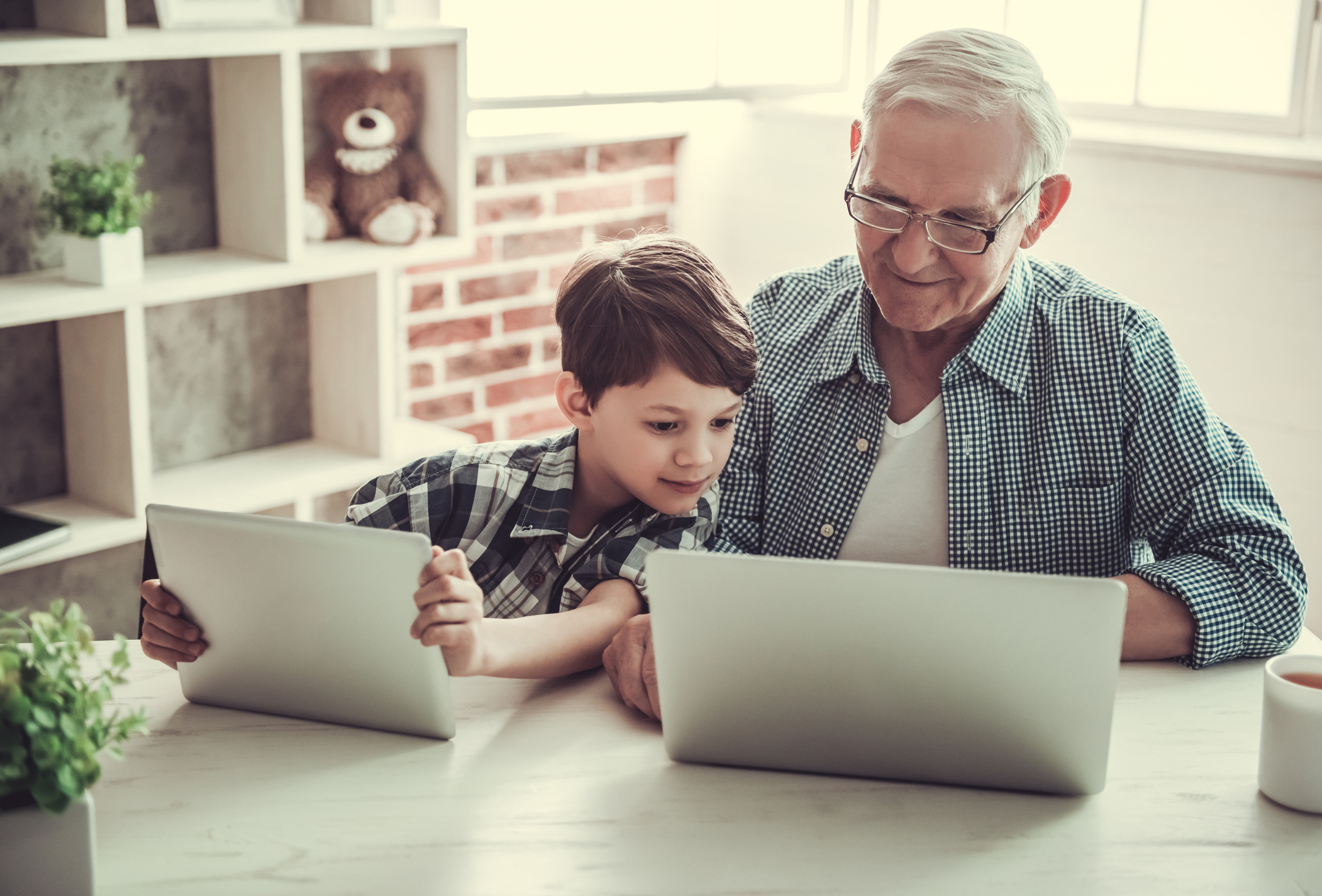 Grandpa and grandson with devices
