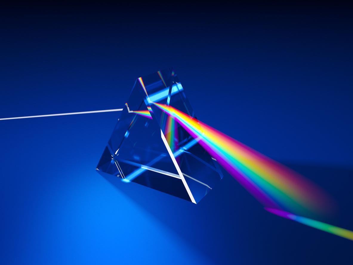 A 3D illustration of a triangular prism dispersing light