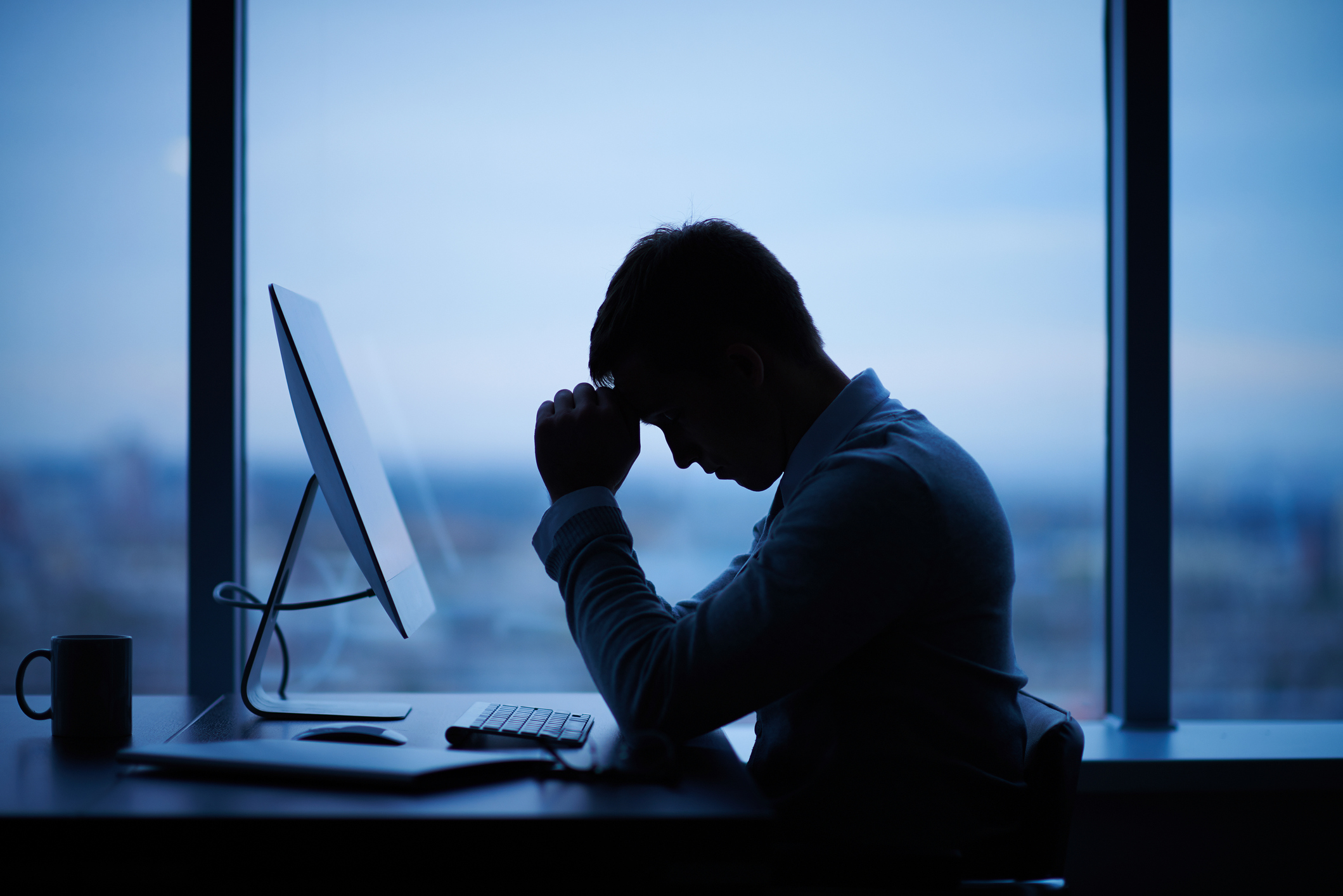 man sat at a laptop